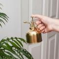 Vaporisateur à plantes vintage en laiton